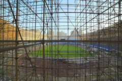 Gymnasium under construction with complicated scaffold Royalty Free Stock Photos