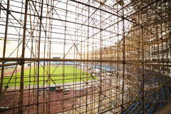 Gymnasium under construction with complicated scaffold Royalty Free Stock Photography