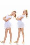 gymnast 2 κοριτσιών στα άσπρα κοστούμια Στοκ εικόνες με δικαίωμα ελεύθερης χρήσης