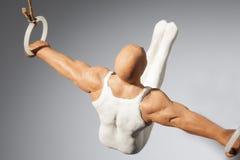Gymnast στα δαχτυλίδια Στοκ εικόνα με δικαίωμα ελεύθερης χρήσης