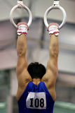 Gymnast auf Ringen Stockbilder