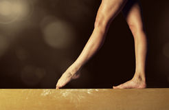 Gymnast on a balance beam stock photos