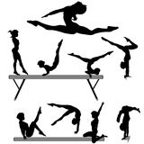 Gymnast balance beam gymnastics silhouette. Silhouettes set of a female gymnast or gymnasts doing balance beam gymnastics exercises Royalty Free Stock Photo