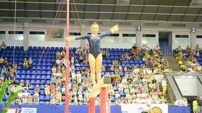 Gymnast balance beam jumping, Ukraine Nation Cup 2015, sport gymnastics competition, Kiev,. KIEV - MAY 24: Ukraine Nation CUP (Stella Zakharova Cup) 2015 stock footage