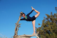 Gymnast balancing in a dead tree Stock Photo