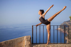 Gymnast or ballet dancer outside stretching Royalty Free Stock Photos