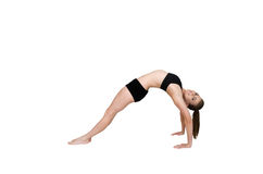 Gymnast bending over backwards arching her back Royalty Free Stock Images