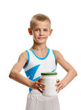 Gymnast with bodybuilding supplement Royalty Free Stock Photos
