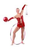 Gymnast bonito da menina com uma esfera imagem de stock royalty free