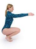 Gymnast che squating Fotografie Stock Libere da Diritti