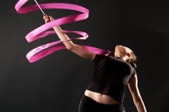 Gymnast com fita cor-de-rosa imagem de stock royalty free