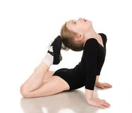 Gymnast cute little girl doing exercises  Stock Images