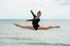 Gymnast Dancer Jumping On The Sea Beach Royalty Free Stock Photo