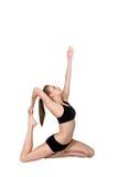 Gymnast, der in Richtung zum Himmel zeigt Stockfotos