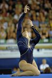 Gymnast floor 01. A female gymnast preforms a floor routine during competition Stock Images