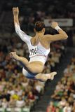 Gymnast floor 02. A female gymnast preforms a routine on the balance beam during competition Stock Image