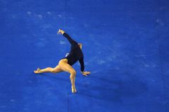 Gymnast floor 03. A female gymnast preforms a floor routine during competition Royalty Free Stock Image