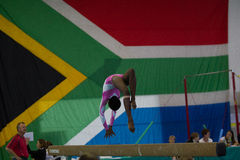 Gymnast Girl Beam  Handstand Roll Focus Flag Royalty Free Stock Image
