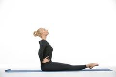 Gymnast girl does exercise Stock Photos