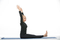 Gymnast girl does exercise Stock Photo
