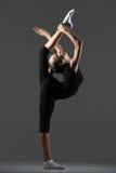Gymnast girl doing standing backbend Stock Photography
