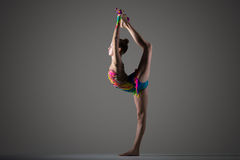 Gymnast girl doing standing backbend with mace Royalty Free Stock Images