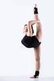 Gymnast girl doing standing split Royalty Free Stock Image