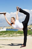 Gymnast girl doing stretching exercise Royalty Free Stock Photo