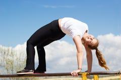 Gymnast girl doing stretching exercise Royalty Free Stock Image
