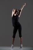 Gymnast girl exercising stock image