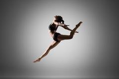 Gymnast girl jumping stock image