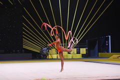 Gymnast girl perform at rhythmic gymnastics competition Stock Image