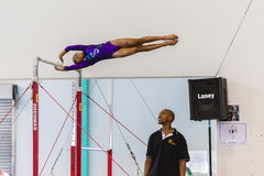 Gymnast Girl Swinging Bars Coach Stock Photo