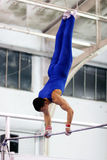 Gymnast on high bar Stock Photography