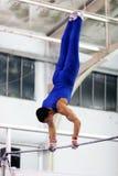Gymnast on high bar stock photography