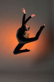 Gymnast jumping Stock Photography