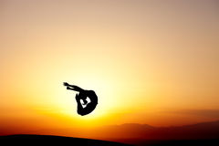 Gymnast jumping in sunset Stock Images