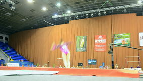 Gymnast jumping, Ukraine Nation Cup 2015, sport gymnastics competition, Kiev,. KIEV - MAY 24: Ukraine Nation CUP (Stella Zakharova Cup) 2015, International sport stock video footage