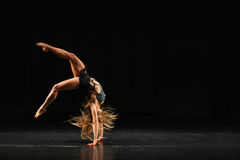 Gymnast performing handspring. On empty stage Stock Photography