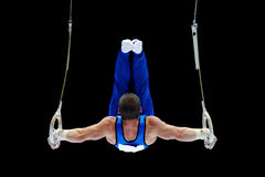 Gymnast Performing On The Rings royalty free stock images