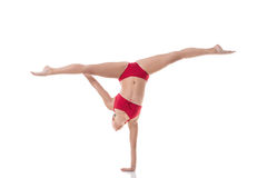 Gymnast performs splits while doing handstand Royalty Free Stock Images