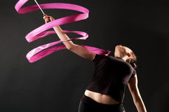 Gymnast with pink ribbon Royalty Free Stock Image
