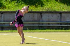 The gymnast. Portrait of a beautiful girl outdoors. Children`s sports royalty free stock images