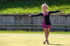 The gymnast. Portrait of a beautiful girl outdoors. Children`s sports stock images