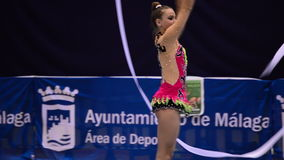 Gymnast with ribbons on rhythmic gymnastics tournament stock video footage