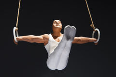 Gymnast on the rings. Figure of a gymnast on the rings royalty free stock photo