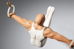 Gymnast on the rings. Figure of a gymnast on the rings royalty free stock image