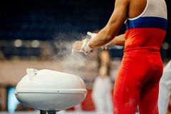 Free Gymnast Rubs Chalk On His Hands Royalty Free Stock Images - 118420709