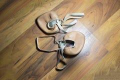 Gymnast's toe shoes on wooden floor. Gymnast's toe old shoes on wooden floor royalty free stock images