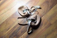 Gymnast's toe shoes on wooden floor. Gymnast's toe old shoes on wooden floor royalty free stock image